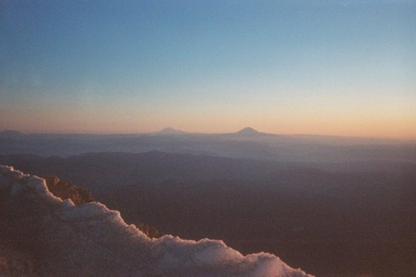 View from top of Mount Hood with Mount Rainier in the distance